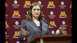FILE - In this April 13, 2018, file photo, Lindsay Whalen addresses the media after she was introduced as Minnesota's new women's NCAA college basketball coach, in Minneapolis. The Minnesota Lynx will honor Lindsay Whalen with a ceremony this season to mark the first jersey retirement by the 20-year-old franchise. The Lynx announced Thursday, April 18, 2019, they will hang Whalen's number 13 from the Target Center rafters, at their June 8 game against the rival Los Angeles Sparks. (AP Photo/Jim Mone, File)