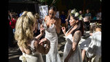 FILE - In this Jan. 26, 2019 file photo models wearing wedding dresses get ready smoke marijuana during the Cannabis Wedding Expo in Los Angeles. U.S. retail sales of cannabis products jumped to $10.5 billion last year, a threefold increase from 2017, according to data from Arcview Group, a cannabis investment and market research firm. The figures do not include retail sales of hemp-derived CBD products. (AP Photo/Richard Vogel, File)