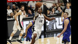 San Antonio Spurs center LaMarcus Aldridge (12) drives to the basket past Denver Nuggets center Nikola Jokic, right, during the first half of Game 3 of an NBA basketball playoff series in San Antonio, Thursday, April 18, 2019. (AP Photo/Eric Gay)