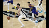 San Antonio Spurs guard Derrick White (4) drives past Denver Nuggets guard Jamal Murray (27) during the first half of Game 3 of an NBA basketball playoff series in San Antonio, Thursday, April 18, 2019. (AP Photo/Eric Gay)