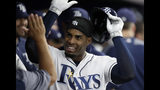 Tampa Bay Rays' Yandy Diaz celebrates in the dugout after his home run off Baltimore Orioles pitcher David Hess during the third inning of a baseball game Wednesday, April 17, 2019, in St. Petersburg, Fla. (AP Photo/Chris O'Meara)