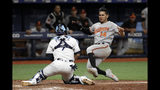 Tampa Bay Rays catcher Michael Perez (7) prepares to tag out Baltimore Orioles' Rio Ruiz (14) as he tried to score on an RBI double by Joey Rickard off relief pitcher Diego Castillo during the 11th inning of a baseball game Thursday, April 18, 2019, in St. Petersburg, Fla. (AP Photo/Chris O'Meara)