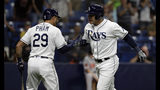 Tampa Bay Rays' Avisail Garcia celebrates with Tommy Pham (29) after Garcia hit a solo home run off Baltimore Orioles relief pitcher Mychal Givens during the ninth inning of a baseball game Thursday, April 18, 2019, in St. Petersburg, Fla. (AP Photo/Chris O'Meara)