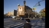 FILE- In this April 26, 2018 file photo, a Jewish boy walks to a yeshiva in the Brooklyn borough of New York. On Thursday, April 18, 2019, a judge has struck down New York State Education Department guidelines for ensuring that private schools including religious schools provide instruction that's substantially equivalent to what public schools provide. The ruling by a state supreme court judge in Albany, N.Y., nullifies guidelines intended to ensure that ultra-Orthodox yeshivas teach secular subjects like English and math. (AP Photo/Mark Lennihan, File)