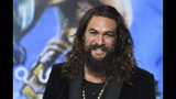 "FILE - In this Dec. 12, 2018 file photo, Jason Momoa arrives at the premiere of ""Aquaman"" at TCL Chinese Theatre in Los Angeles. Momoa on Wednesday, April 17, 2019 released a video in which he shaved off his signature beard and mustache in order to promote recycling. He started by saying farewell to his ""Game of Thrones"" and DC characters Drogo and Arthur Curry. Momoa said he thought he last shaved in 2012. (Photo by Jordan Strauss/Invision/AP, File)"