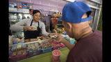 Genesis Perez Martinez, 24, works at the Plaza del Mercado in the Rio Piedras area of San Juan, Puerto Rico, Wednesday, April 17, 2019. The San Juan area has lost 3.9% of its population since Hurricane Maria. (AP Photo/Carlos Giusti)