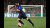 Barcelona forward Luis Suarez runs with the ball during the Champions League quarterfinal, second leg, soccer match between FC Barcelona and Manchester United at the Camp Nou stadium in Barcelona, Spain, Tuesday, April 16, 2019. (AP Photo/Joan Monfort)