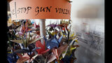 FILE - In this March 23, 2019, file photo, origami cranes, a symbol of peace, hang in the Columbine High School library in Littleton, Colo., near where several survivors and family members of the victims gathered to speak about the upcoming 20th anniversary of the April 20, 1999, shooting. In the two decades since the Columbine High School massacre, therapists still struggle with how to help people cope. (AP Photo/Thomas Peipert, File)