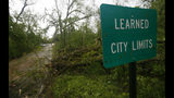 Fallen trees line the roads leading into the small community of Learned, Miss., Thursday, April 18, 2019. Several homes were damaged by fallen trees in the tree lined community. Strong storms again roared across the South on Thursday, topping trees and leaving more than 100,000 people without power across Mississippi, Louisiana and Texas. (AP Photo/Rogelio V. Solis)