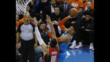 Oklahoma City Thunder guard Russell Westbrook, right, shoots in front of Portland Trail Blazers center Enes Kanter (00) I the first half of Game 3 of an NBA basketball first-round playoff series Friday, April 19, 2019, in Oklahoma City. (AP Photo/Sue Ogrocki)