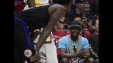 Boxer Floyd Mayweather Jr., right, looks at Los Angeles Clippers guard Patrick Beverley during the first half in Game 3 of the Clippers' first-round NBA basketball playoff series against the Golden State Warriors on Thursday, April 18, 2019, in Los Angeles. (AP Photo/Mark J. Terrill)