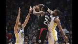 Los Angeles Clippers guard Lou Williams, center, tries to shoot as Golden State Warriors guard Stephen Curry, left, and guard Andre Iguodala defend during the first half in Game 3 of a first-round NBA basketball playoff series Thursday, April 18, 2019, in Los Angeles. (AP Photo/Mark J. Terrill)