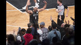 Brooklyn Nets forward Jared Dudley (6) reacts with the fans during the first half of of Game 4 of a first-round NBA basketball playoff series against the Philadelphia 76ers, Saturday, April 20, 2019, in New York. (AP Photo/Mary Altaffer)