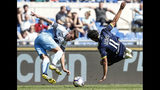 Lazio's Sergej Milinkovic-Savic, left, and Chievo Verona's Medhi Leris vie for the ball during the Italian Serie A soccer match between Lazio and Chievo Verona at the Olympic stadium in Rome, Italy, Saturday, April 20, 2019. (Giuseppe Lami/ANSA via AP)