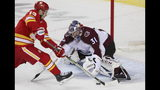 Calgary Flames left wing Johnny Gaudreau (13) is stopped on a penalty shot by Colorado Avalanche goaltender Philipp Grubauer (31) during the first period of Game 5 of an NHL hockey first-round playoff series Friday, April 19, 2019, in Calgary, Alberta. (Dave Chidley/The Canadian Press via AP)