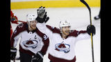 Colorado Avalanche center Colin Wilson (22) celebrates his goal against the Calgary Flames with teammate Gabriel Landeskog (92) during the second period of Game 5 of an NHL hockey first-round playoff series Friday, April 19, 2019, in Calgary, Alberta. (Larry MacDougal/The Canadian Press via AP)