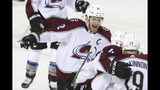 Colorado Avalanche left wing Gabriel Landeskog (92) celebrates his goal with teammates during the first period of Game 5 against the Calgary Flames in an NHL hockey first-round playoff series Friday, April 19, 2019, in Calgary, Alberta. (Dave Chidley/The Canadian Press via AP)