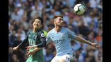 Manchester City's Aymeric Laporte, right, fights for the ball with Tottenham's Heung-Min Son during the English Premier League soccer match between Manchester City and Tottenham Hotspur at Etihad stadium in Manchester, England, Saturday, April 20, 2019. (AP Photo/Rui Vieira)