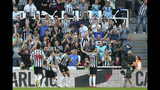 Newcastle United's Ayoze Perez, right, celebrates scoring his side's first goal of the game against Southampton during their English Premier League soccer match at St James' Park in Newcastle, England, Saturday April 20, 2019. (Richard Sellers/PA via AP)