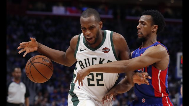 70aa618b024 Detroit Pistons guard Ish Smith knocks the ball away from Milwaukee Bucks  forward Khris Middleton (22) during the first half of Game 3 of a  first-round NBA ...