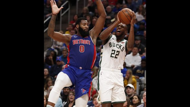 074074ee904 Milwaukee Bucks forward Khris Middleton (22) shoots as Detroit Pistons  center Andre Drummond (0) defends during the first half of Game 3 of a  first-round ...