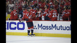 Washington Capitals center Nicklas Backstrom (19), of Sweden, celebrates his goal with the bench during the first period of Game 5 of an NHL hockey first-round playoff series against the Carolina Hurricane, Saturday, April 20, 2019, in Washington. (AP Photo/Nick Wass)