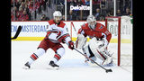 Carolina Hurricanes center Sebastian Aho (20), of Finland, skates with the puck against Washington Capitals goaltender Braden Holtby (70)during the first period of Game 5 of an NHL hockey first-round playoff series, Saturday, April 20, 2019, in Washington. (AP Photo/Nick Wass)