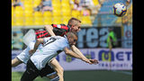 Parma's Antonino Barilla', bottom, and AC Milan's Andrea Conti vie for the ball during a Serie A soccer match between Parma and AC Milan at the Ennio Tardini Stadium in Parma, Italy, Saturday, April 20, 2019. (Elisabetta Baracchi/ANSA via AP)