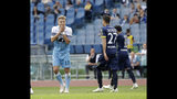 Lazio's Ciro Immobile reacts after missing a scoring chance during a Serie A soccer match between Lazio and Chievo Verona at Rome's Olympic stadium, Saturday, April 20, 2019. (AP Photo/Alessandra Tarantino)