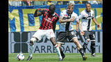 AC Milan's Tiemoue Bakayoko, left, and Parma's Jurai Kucka vie for the ball during a Serie A soccer match between Parma and AC Milan at the Ennio Tardini Stadium in Parma, Italy, Saturday, April 20, 2019. (Elisabetta Baracchi/ANSA via AP)