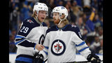 Winnipeg Jets' Patrik Laine (29), of Finland, and Kyle Connor (81) talk during the third period in Game 6 of an NHL first-round hockey playoff series against the St. Louis Blues, Saturday, April 20, 2019, in St. Louis. (AP Photo/Jeff Roberson)