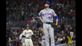 New York Mets' Jacob deGrom (48) takes a deep breath after walking Atlanta Braves Freddie Freeman, left, during the third inning of a baseball game Sunday, April 14, 2019, in Atlanta. (AP Photo/John Amis)