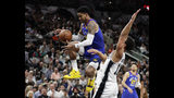 Denver Nuggets guard Gary Harris, left, drives to the basket past San Antonio Spurs guard Bryn Forbes (11) during the first half of Game 4 of an NBA basketball playoff series in San Antonio, Saturday, April 20, 2019. (AP Photo/Eric Gay)