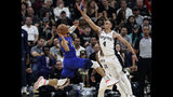 Denver Nuggets guard Jamal Murray, left, leaps past San Antonio Spurs guard Derrick White (4) during the first half of Game 4 of an NBA basketball playoff series in San Antonio, Saturday, April 20, 2019. (AP Photo/Eric Gay)