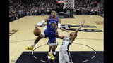 Denver Nuggets guard Gary Harris (14) drives to the basket past San Antonio Spurs guard Bryn Forbes (11) during the first half of Game 4 of an NBA basketball playoff series in San Antonio, Saturday, April 20, 2019. (AP Photo/Eric Gay)
