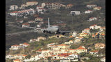 A German air force (Luftwaffe) plane comes into land at Madeira international airport in Funchal, the capital of Portugal's Madeira Island, Saturday April 20, 2019. A German plane is due to take home some of the injured survivors in Wednesday's bus crash in Madeira. (AP Photo/Armando Franca)