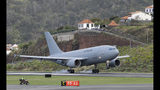 A German air force (Luftwaffe) plane lands at Madeira international airport in Funchal, the capital of Portugal's Madeira Island, Saturday April 20, 2019. A German plane is due to take home some of the injured survivors in Wednesday's bus crash in Madeira. (AP Photo/Armando Franca)
