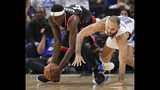 Toronto Raptors' Pascal Siakam, left, grabs the ball in front of Orlando Magic's Evan Fournier during the second half in Game 3 of a first-round NBA basketball playoff series, Friday, April 19, 2019, in Orlando, Fla. (AP Photo/John Raoux)