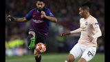 Barcelona forward Luis Suarez, left, duels for the ball with Manchester United's Chris Smalling during the Champions League quarterfinal, second leg, soccer match between FC Barcelona and Manchester United at the Camp Nou stadium in Barcelona, Spain, Tuesday, April 16, 2019. (AP Photo/Manu Fernandez)