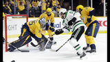 Nashville Predators goaltender Pekka Rinne (35), of Finland, blocks a shot by Dallas Stars center Tyler Seguin (91) during the first period in Game 5 of an NHL hockey first-round playoff series Saturday, April 20, 2019, in Nashville, Tenn. (AP Photo/Mark Humphrey)