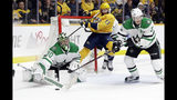 Dallas Stars goaltender Ben Bishop (30) blocks a shot as Nashville Predators center Nick Bonino (13) collides with the net during the second period in Game 5 of an NHL hockey first-round playoff series Saturday, April 20, 2019, in Nashville, Tenn. (AP Photo/Mark Humphrey)