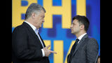 Ukrainian presidential candidate and popular comedian Volodymyr Zelenskiy listens to Ukrainian President Petro Poroshenko during their final electoral campaign debate at the Olympic stadium in Kiev, Ukraine, Friday, April 19, 2019. Friday is the last official day of election canvassing in Ukraine as all presidential candidates and their campaigns will be barred from campaigning on Saturday, the day before the vote. (AP Photo/Vadim Ghirda)