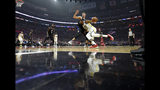 Golden State Warriors guard Stephen Curry drives against Los Angeles Clippers forward Danilo Gallinari during the first half in Game 3 of a first-round NBA basketball playoff series Thursday, April 18, 2019, in Los Angeles. (AP Photo/Mark J. Terrill)