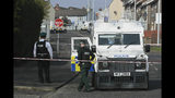Police at the scene in Londonderry, Northern Ireland, Friday April 19, 2019, following the death of 29-year-old journalist Lyra McKee who was shot and killed during overnight rioting. Police in Northern Ireland said Friday the dissident republican group the New IRA was probably responsible for the fatal shooting of a journalist during overnight rioting in the city of Londonderry. (Brian Lawless/PA via AP)