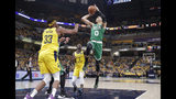 Boston Celtics forward Jayson Tatum (0) shoots over Indiana Pacers center Myles Turner (33) during the first half of Game 4 of an NBA basketball first-round playoff series in Indianapolis, Sunday, April 21, 2019. (AP Photo/Michael Conroy)