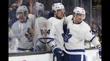 Toronto Maple Leafs' Auston Matthews (34) celebrates his goal with teammate Nikita Zaitsev (22) during the third period in Game 5 of an NHL hockey first-round playoff series against the Boston Bruins in Boston, Friday, April 19, 2019. (AP Photo/Michael Dwyer)
