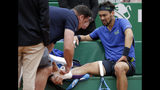 Italy's Fabio Fognini is treated for an injury during the men's singles final match of the Monte Carlo Tennis Masters tournament against Serbia's Dusan Lajovic in Monaco, Sunday, April, 21, 2019. (AP Photo/Claude Paris)
