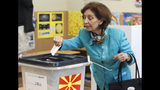 """Gordana Siljanovska Davkova, a presidential candidate for the opposition conservative VMRO-DPMNE party, casts her ballot for the presidential elections at a polling station in Skopje, North Macedonia, Sunday, April 21, 2019. North Macedonia holds the first round of presidential elections on Sunday, seen as key test of the government following deep polarization after the country changed its name to end a decades-old dispute with neighboring Greece over the use of the term """"Macedonia"""". (AP Photo/Boris Grdanoski)"""