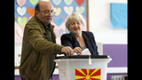 """A couple cast their ballots for the presidential election at a polling station in Skopje, North Macedonia, Sunday, April 21, 2019. Polls were opened early on Sunday in North Macedonia for presidential elections seen as key test of the government following deep polarization after the country changed its name to end a decades-old dispute with neighboring Greece over the use of the term """"Macedonia"""". (AP Photo/Boris Grdanoski)"""