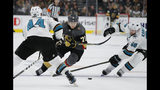 Vegas Golden Knights center William Karlsson (71) skates between San Jose Sharks defenseman Marc-Edouard Vlasic, left, and center Melker Karlsson during the second period in Game 6 of a first-round NHL hockey playoff series Sunday, April 21, 2019, in Las Vegas. (AP Photo/John Locher)